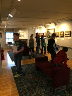 Students examine paintings at the PMM